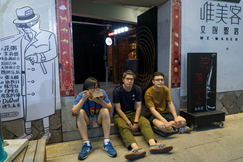 (L-R) Atie, kk (who's also the drummer of The Romp) and Deryck Chang, three of the four managers of Maker Live pose for a photo at the door of the venue.
